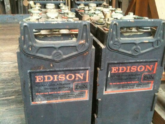 A microgrid has backup power. Familiar types of batteries store power. These date to 1901.