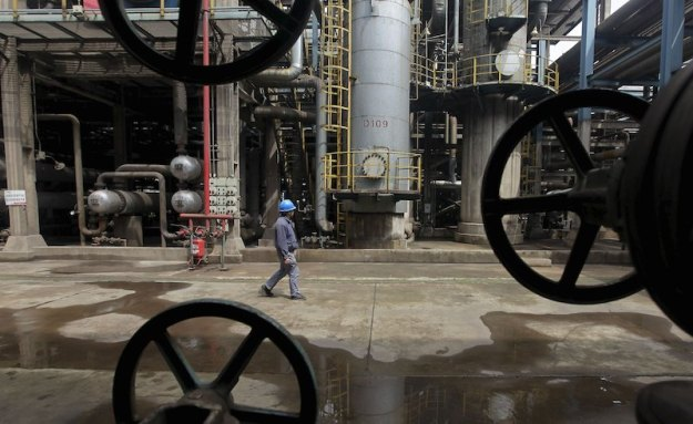 A worker walks past oil pipes at a refinery in China. Reuters / Stringer / Files The Asia File – Nov 11 2015