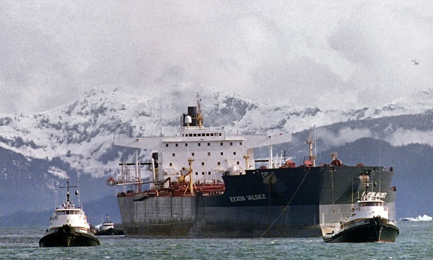Tugboats tow the oil tanker Exxon Valdez off Bligh Reef in Prince William Sound 5 April 1989. Exxon became aware of climate change as early as 1981, according to a newly discovered email. Photograph: Chris Wilkins/AFP/Getty Images