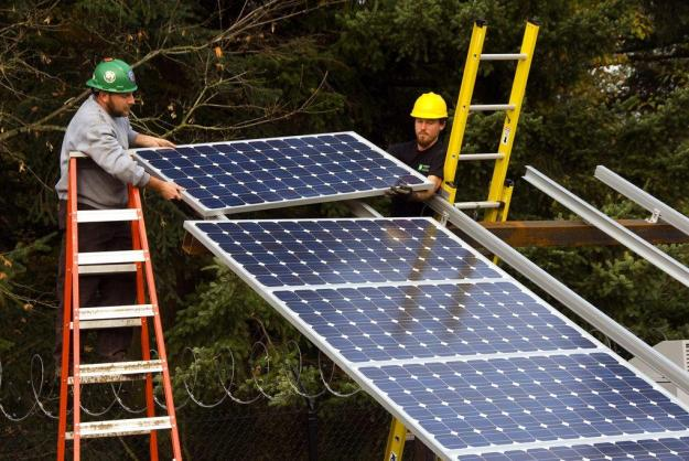 Installing solar panels in Oregon. Credit Oregon Department of Transportation