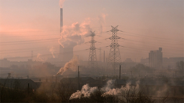 Chimneys spew pollution in an ailing industrial city in China's northeast. Mark Henley / Ropi / Zuma Press