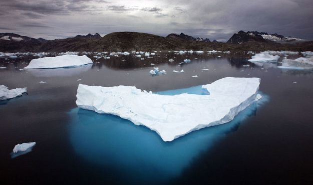 Icebergs float in a bay off Ammassalik Island, Greenland. (AP photo / John McConnico)