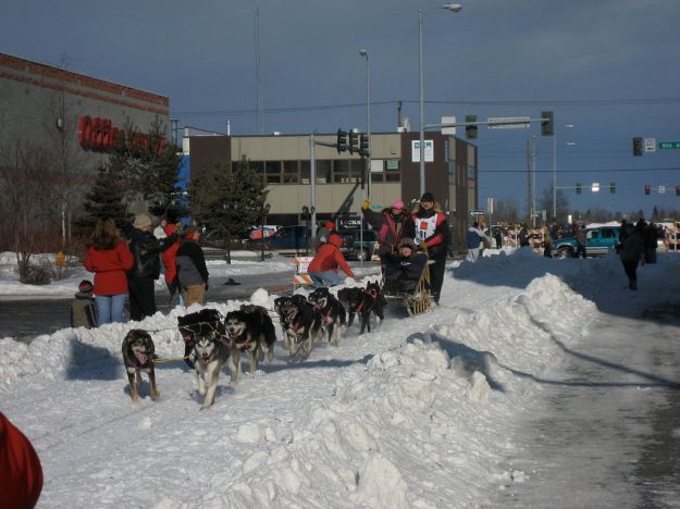 Iditarod start in Anchorage, 2008. In those days, they did not have to import snow. Photo by David Weekly from Cupertino, CA. CC BY-SA 2.0. Wikimedia Commons.