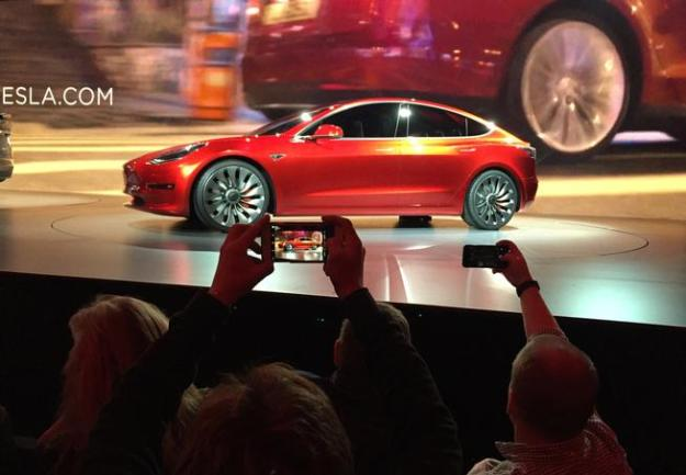 Tesla Motors unveils the Model 3 on Thursday at the Tesla Motors design studio in Hawthorne, Calif. (Justin Prichard, The Associated Press)