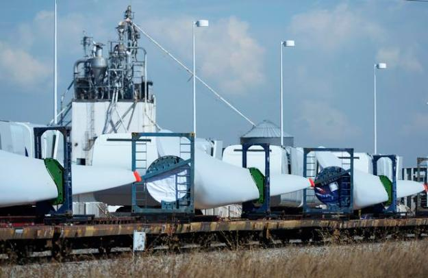Giant Vestas wind turbine blades are loaded on a train awaiting delivery at the plant on Tuesday. (Andy Cross, The Denver Post)