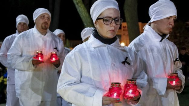 Candles were lit at a ceremony in Slavutych, a town built to re-house workers who lived near the nuclear plant.