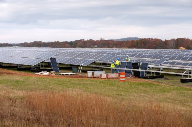 Electricians with Riggs Distler install solar panels for PSE&G. Tracie Van Auken.