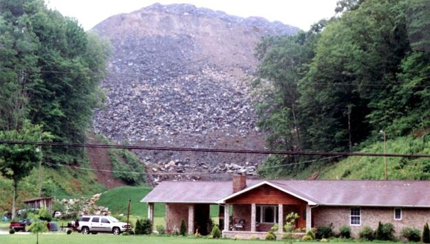 Mountaintop removal coal mining filled the valley behind this home. Photo by Flashdark. Released to the Public Domain. Wikimedia Commons.