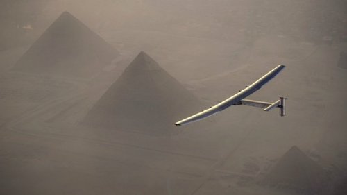 Solar Impulse 2 flies over the pyramids of Giza.