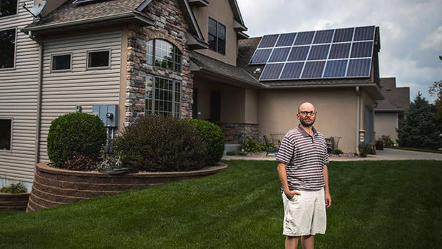 Sam Villella wants to add more panels, but a new electric co-op fee is holding him back. (Minneapolis Star Tribune)