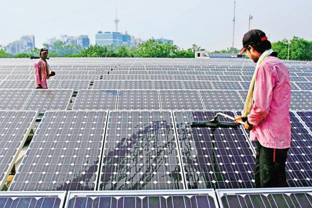 Solar power can help water crop fields and augment farm incomes by feeding the surplus power generated into the grid. Photo: Bloomberg