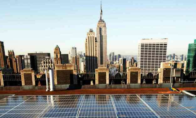 Solar panels on a Rockefeller Center rooftop in midtown Manhattan in New York. (Photograph: Mark Lennihan / AP)