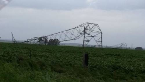 Damaged transmission towers that brought the grid down (Photo: Twitter / Vic_Rollison)