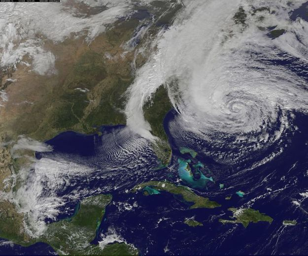 Maybe Sandy would have gone away if NOAA's GOES-13 satellite had not taken this photo. (NASA image, public domain)